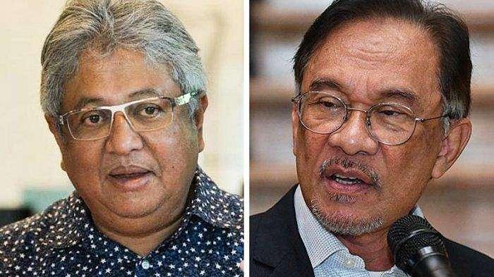 Mantan menteri Zaid Ibrahim (kiri) dan pemimpin oposisi Anwar Ibrahim