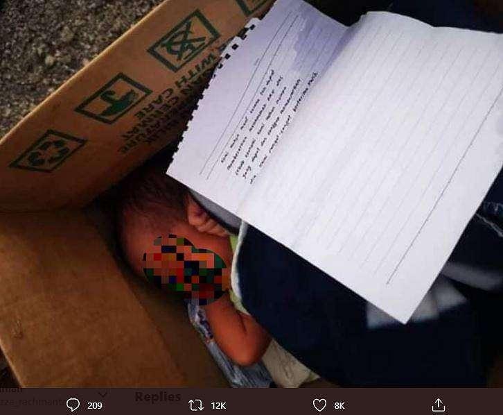 Bayi dalam kardus ini menyimpan pesan yang membuat netizen sedih. (Twitter/ redzuanNewsMPB)