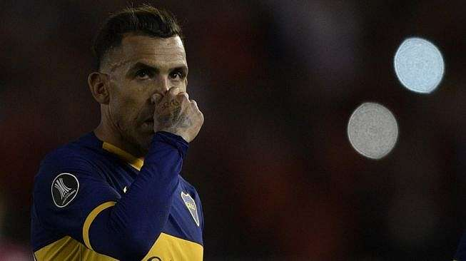 Penyerang Boca Juniors, Carlos Tevez. [JUAN MABROMATA / AFP]